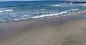 The beauty of autumn waves and beach sand in Pomorie, Bulgaria. Pomorie - famous resort town in Bulgaria. In summer it is a popular tourist destination, mainly stock video