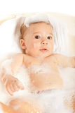 Beauty baby boy in bathtub with foam Royalty Free Stock Photo
