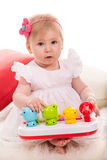 Beauty baby girl playing with toys Stock Photo