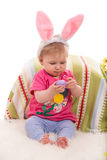 Beauty baby holding egg Royalty Free Stock Images