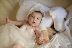 Beauty baby on muppet. Royalty Free Stock Photography