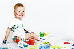 Beauty baby with paint on white Royalty Free Stock Images