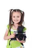 Beauty baby photographer. The beautiful little girl holds the big camera in hands Royalty Free Stock Photography