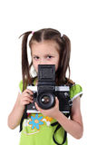 Beauty baby photographer. The beautiful little girl holds the big camera in hands Royalty Free Stock Photo