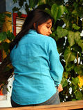 Beauty Back. A beautiful Indian girl in a blue shirt sad about something Royalty Free Stock Photos