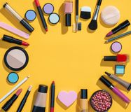 Beauty background with makeup cosmetic products. Photo of different beauty products on yellow background. Copy space for your text royalty free stock image