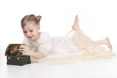 Beauty Ballerina. A Beauty Ballerina young girl open a tresure over white background Royalty Free Stock Images