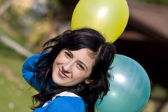 Beauty in balloons. Beautiful teen in balloons background Stock Image