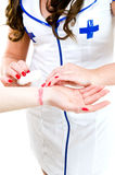 Beauty bandage. Sexy nurse in uniform bandaging hand after accident Stock Images