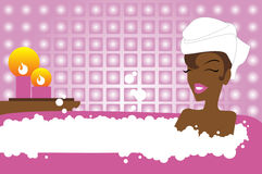 Beauty and bath. African girl relaxed in bathroom Stock Photo