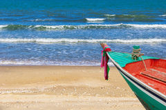 Beauty beach with small boat Stock Image