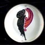 Beauty and Beast Erte square. Erte art deco collectible plate on black velvet background the Beauty and the Beast showing a woman with a flowing headdress or royalty free stock image
