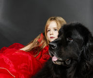 Beauty and the Beast. Girl with big black water-dog. Royalty Free Stock Image
