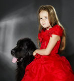 Beauty and the Beast. Girl with big black water-dog. Stock Photography