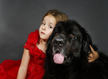 Beauty and the Beast. Girl with big black water-dog. Royalty Free Stock Images