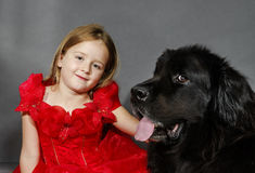 Beauty and the Beast. Girl with big black water-dog. Royalty Free Stock Photography