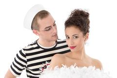 Beauty and the Beast. Young seaman posing with you Royalty Free Stock Images