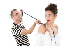 Beauty and the Beast. Young seaman posing with young woman Stock Image
