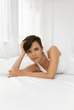 Beauty. Beautiful Woman With Makeup Lying On Bed. Body Care Royalty Free Stock Photo