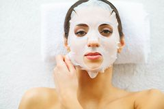 Beauty. Beautiful Woman in the Beauty Salon with Face Mask. Lying on the Massage Tables. Pure and Fresh Skin. Skin Care royalty free stock photos