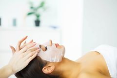 Beauty. Beautiful Woman in the Beauty Salon with Face Mask. Lying on the Massage Tables. Pure and Fresh Skin. Skin Care stock photos