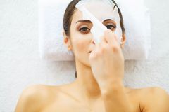 Beauty. Beautiful Woman in the Beauty Salon with Face Mask. Lying on the Massage Tables. Pure and Fresh Skin. Skin Care royalty free stock images