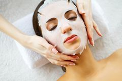 Beauty. Beautiful Woman in the Beauty Salon with Face Mask. Lying on the Massage Tables. Pure and Fresh Skin. Skin Care stock images