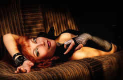 Beauty. Beautiful and young redhead girl lying on a couch Stock Images