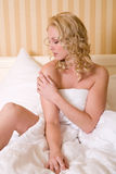 Beauty in bed Stock Photography