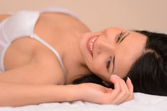 Beauty in bed. Beautiful young woman in lingerie lying on the so Royalty Free Stock Image