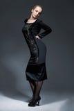 Beauty In Black Dress. Full length portrait of beautiful model in black retro dress, posing Stock Photo