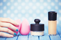 Beauty blender. Female hand and beauty blender stock image