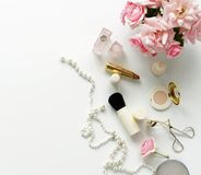Beauty blog concept. Female make up accessories and roses Stock Images