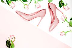 Beauty blog concept. pink nude female shoeson white background. Flat lay, top view trendy fashion feminine background. Feminine accessories and peonies on the Stock Photo