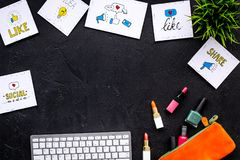 Beauty blogger workplace concept. Keyboard, cosmetics, social media icons on black desk top view space for text. Beauty bloger workplace concept. Keyboard Stock Photos