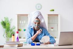 The beauty blogger applying mask and posting to internet blog Stock Image