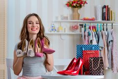 Beauty blogger holding pump shoes stock photos