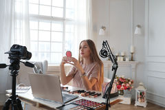 Beauty blogger. Make-up. Beauty blogger at work stock photography
