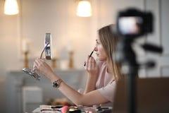 Beauty blogger. Make-up. Beauty blogger at work Stock Photos