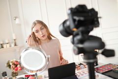 Beauty blogger. Make-up. Beauty blogger at work stock image