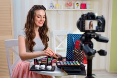 Beauty blogger recording makeup tutorial royalty free stock images