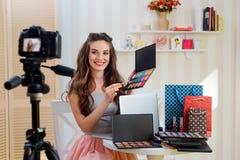 Beauty blogger recording makeup tutorial stock photos