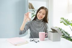Beauty blogger is showing a new beauty product to the camera. She is recording a new video for her channel. The product royalty free stock images