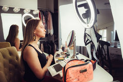 Beauty blogger woman doing makeup turtorial video for the online vlog.  Stock Photography