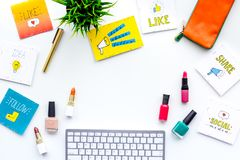Beauty blogger workplace concept. Keyboard, cosmetics, social media icons on white desk top view space for text. Beauty blogger workplace concept. Keyboard Stock Photography
