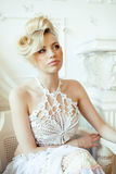 Beauty blond bride in luxury white interiors Stock Images