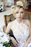 Beauty blond bride in luxury white interiors Royalty Free Stock Photo
