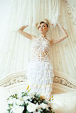 Beauty blond bride in luxury white interiors Stock Photo