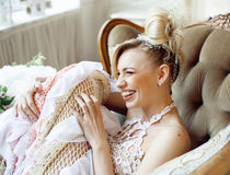 Beauty blond bride in luxury white interiors Royalty Free Stock Image