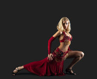 Beauty blond dancer - red oriental arabia costume Stock Image